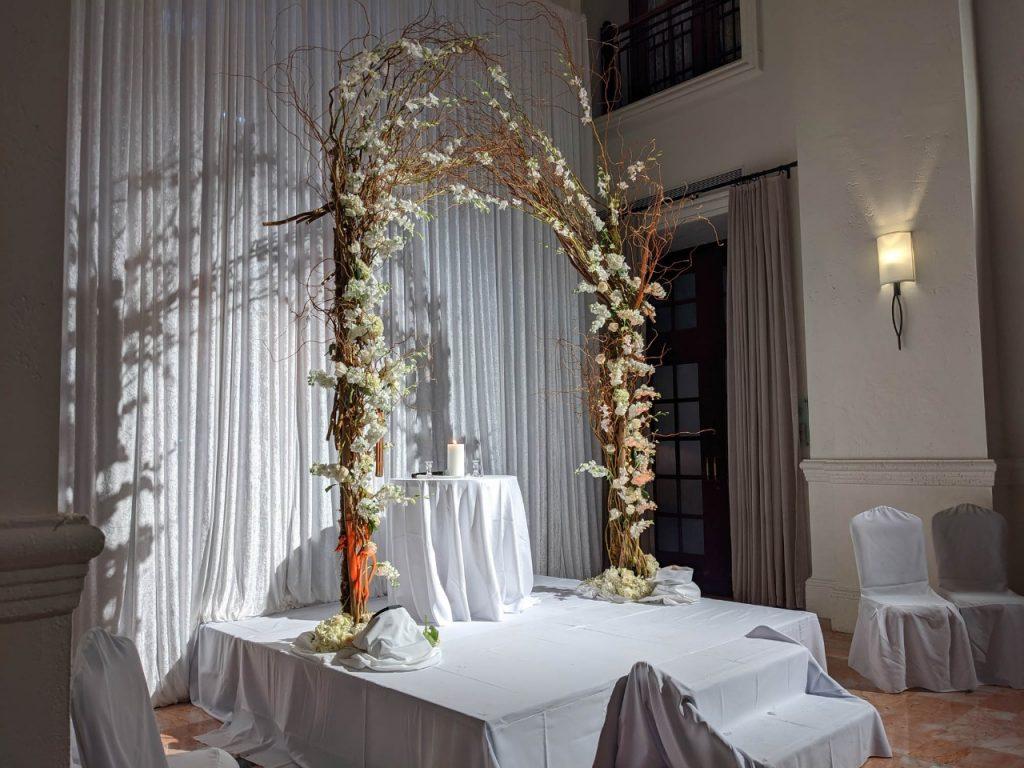 Indoor ceremony wedding willow branch arch